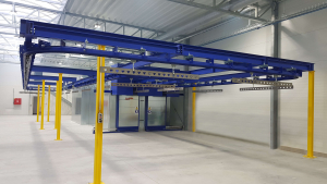Curing oven with overhead conveyor