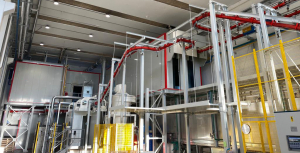 Fully automated high-production rate powder painting plant